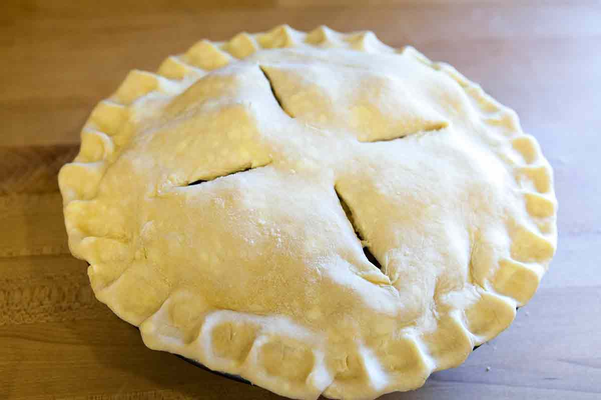 score the top of the apple pie and brush with an egg wash