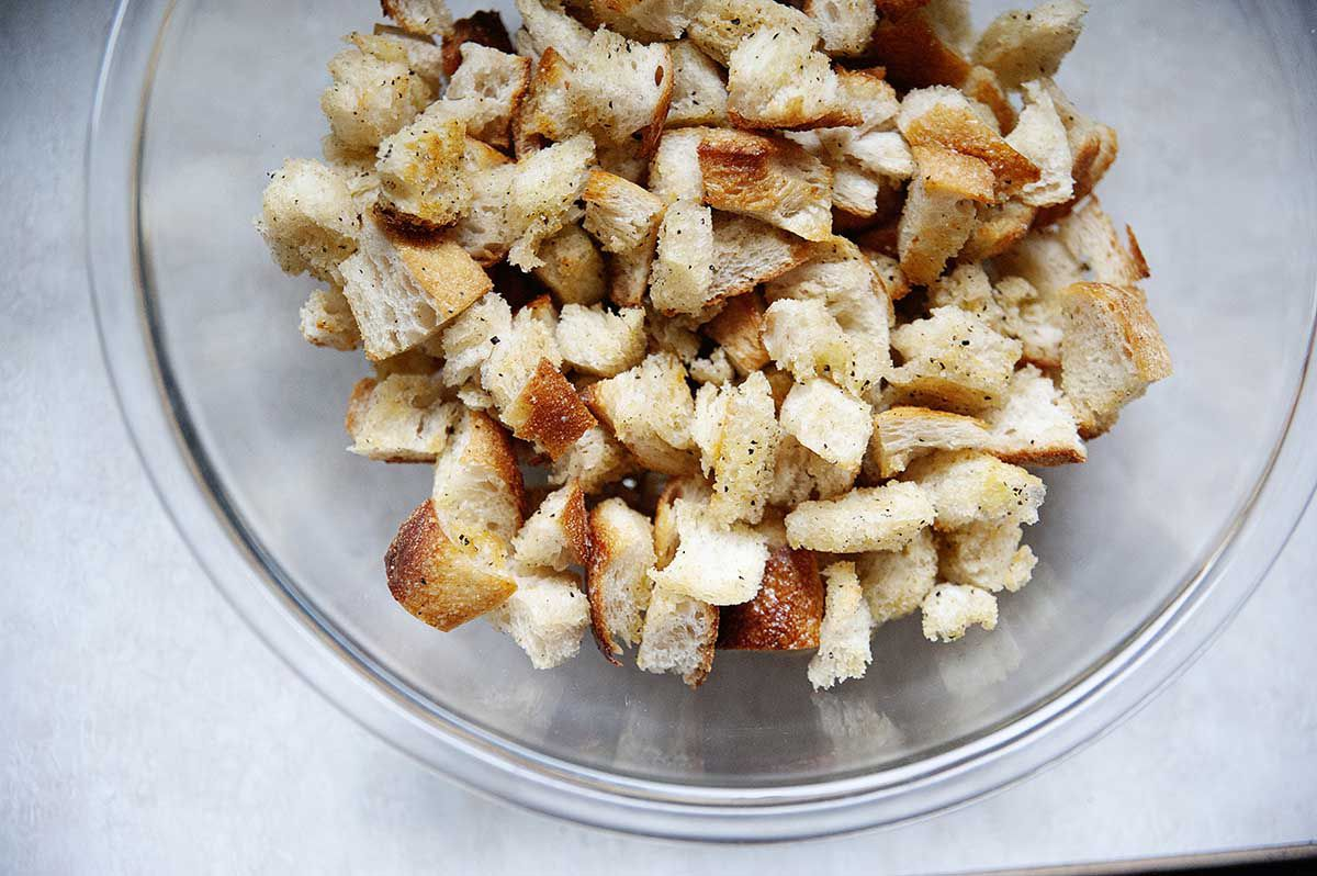 Toasted breadcrumbs in large glass bowl.