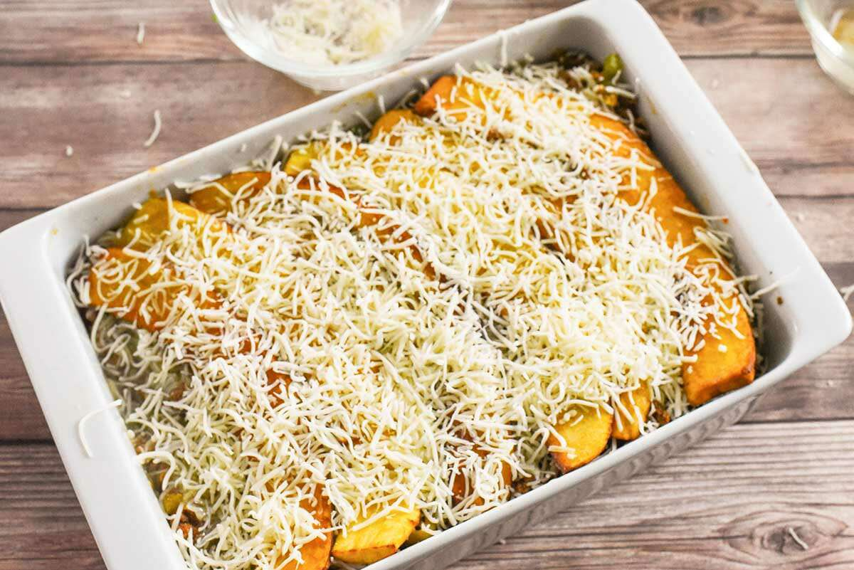 Plantain Lasagna with Beef and Cheese bake the pastelon and add cheese