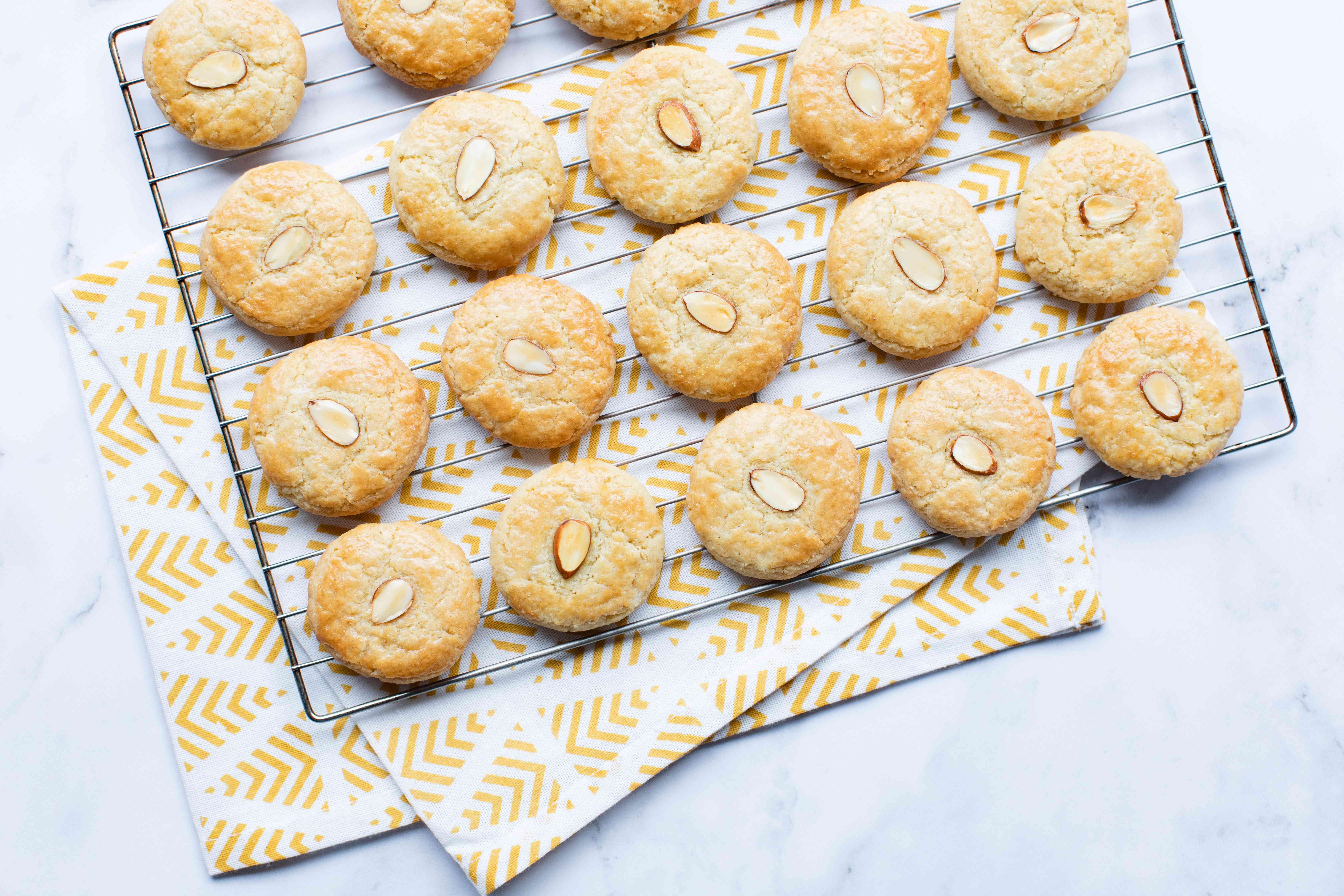 Overhead view of almond cookies on a cooling tray.