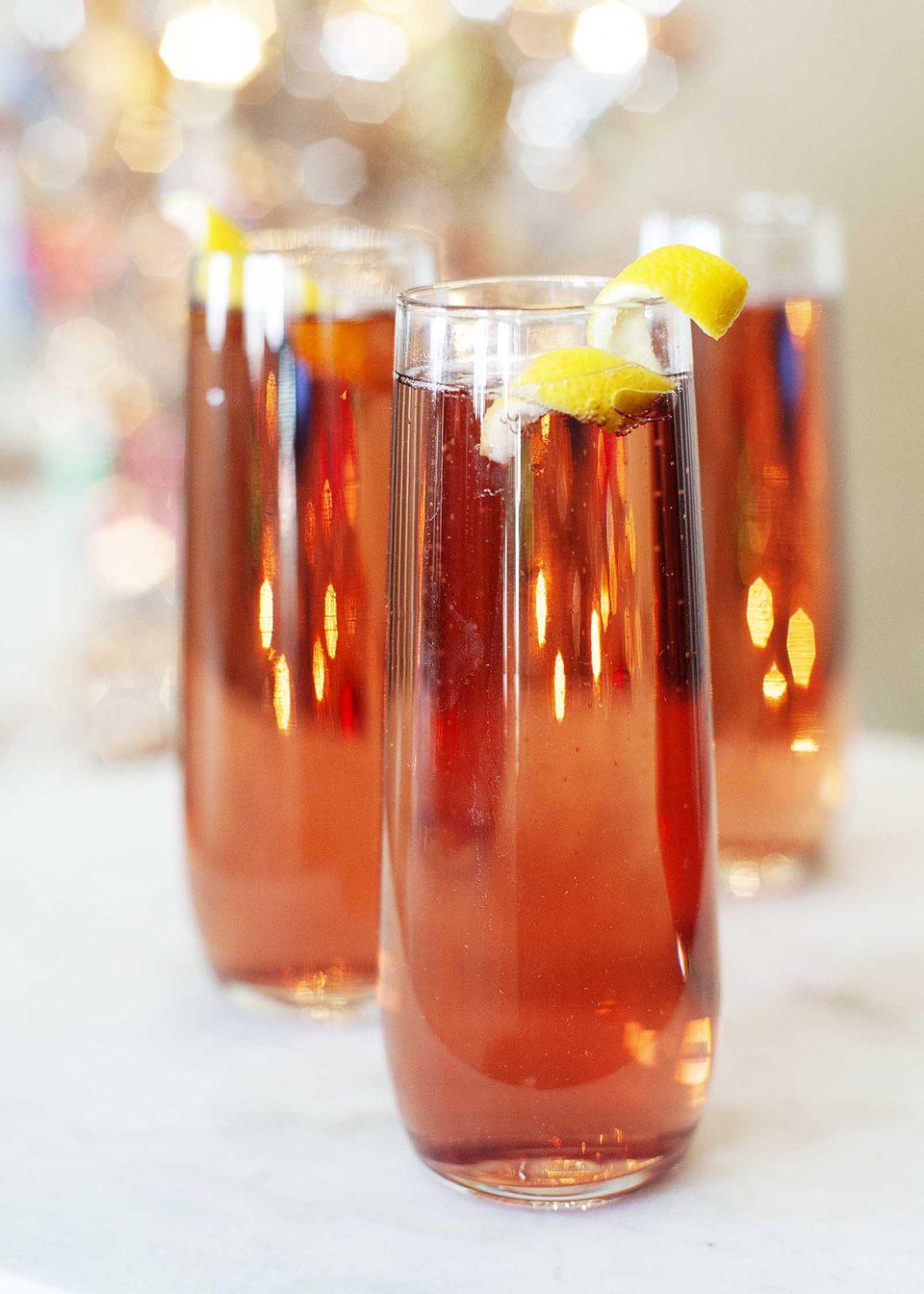 Raspberry liqueur cocktail with lemon peel