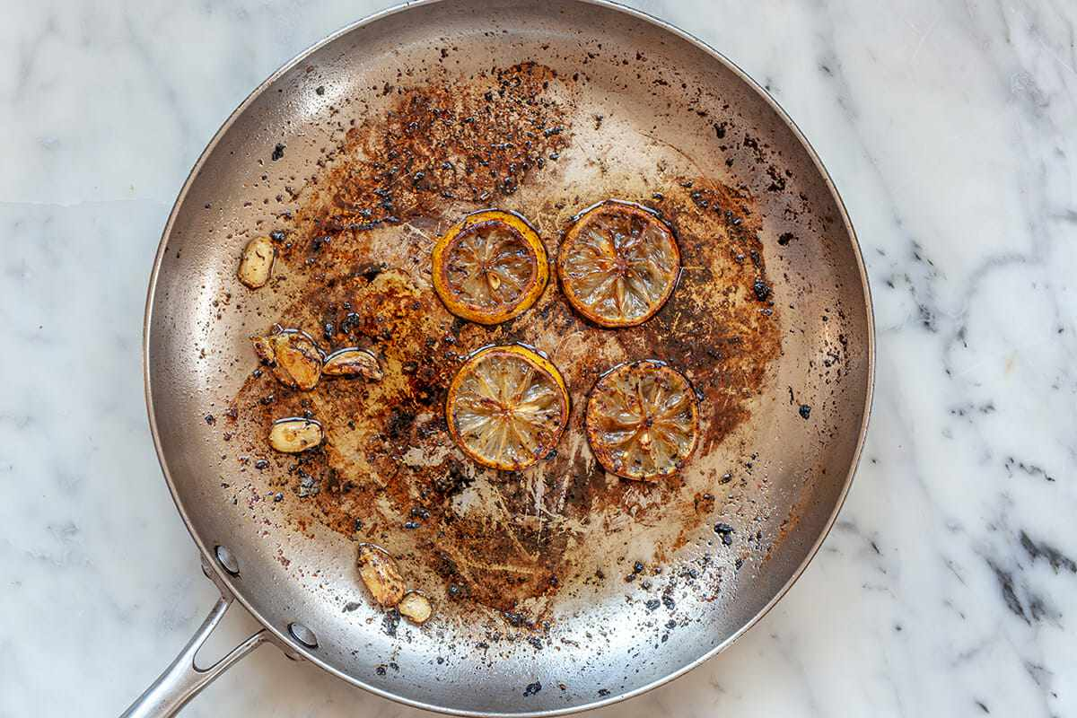 Pork Chops on the Stove Top cook the lemon and garlic