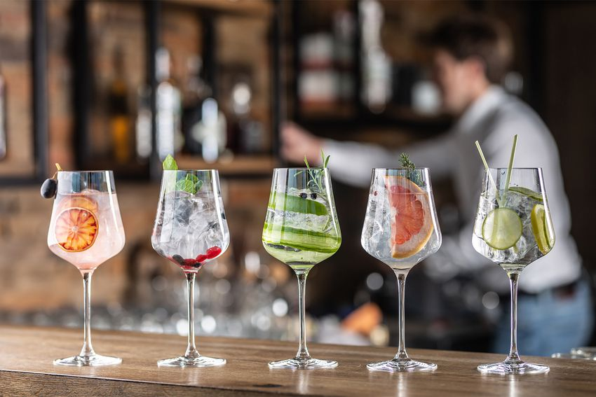 Selection of various cocktails in wine glasses in a bar