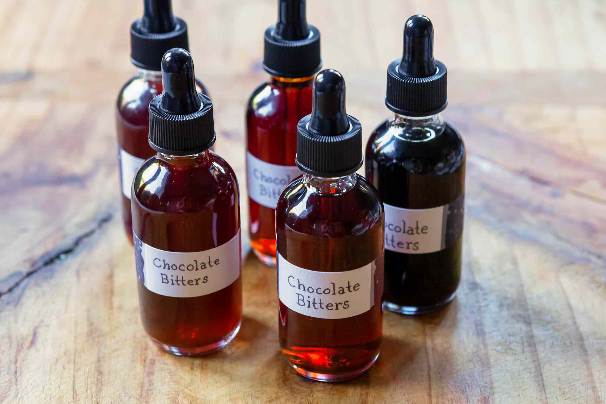 Homemade bitters in small dropper bottles.