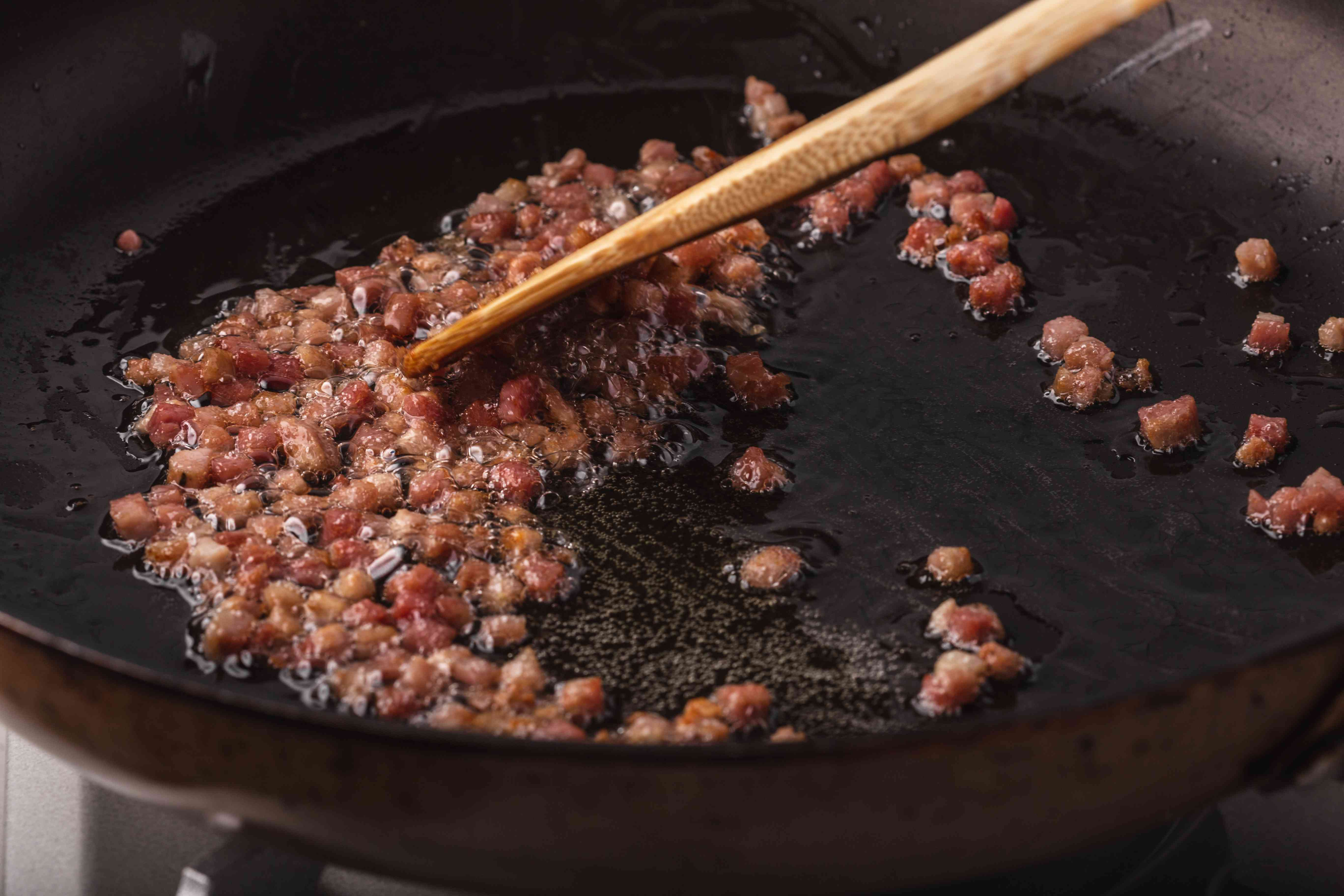 Sauteeing pancetta to make an easy chicken marsala recipe.