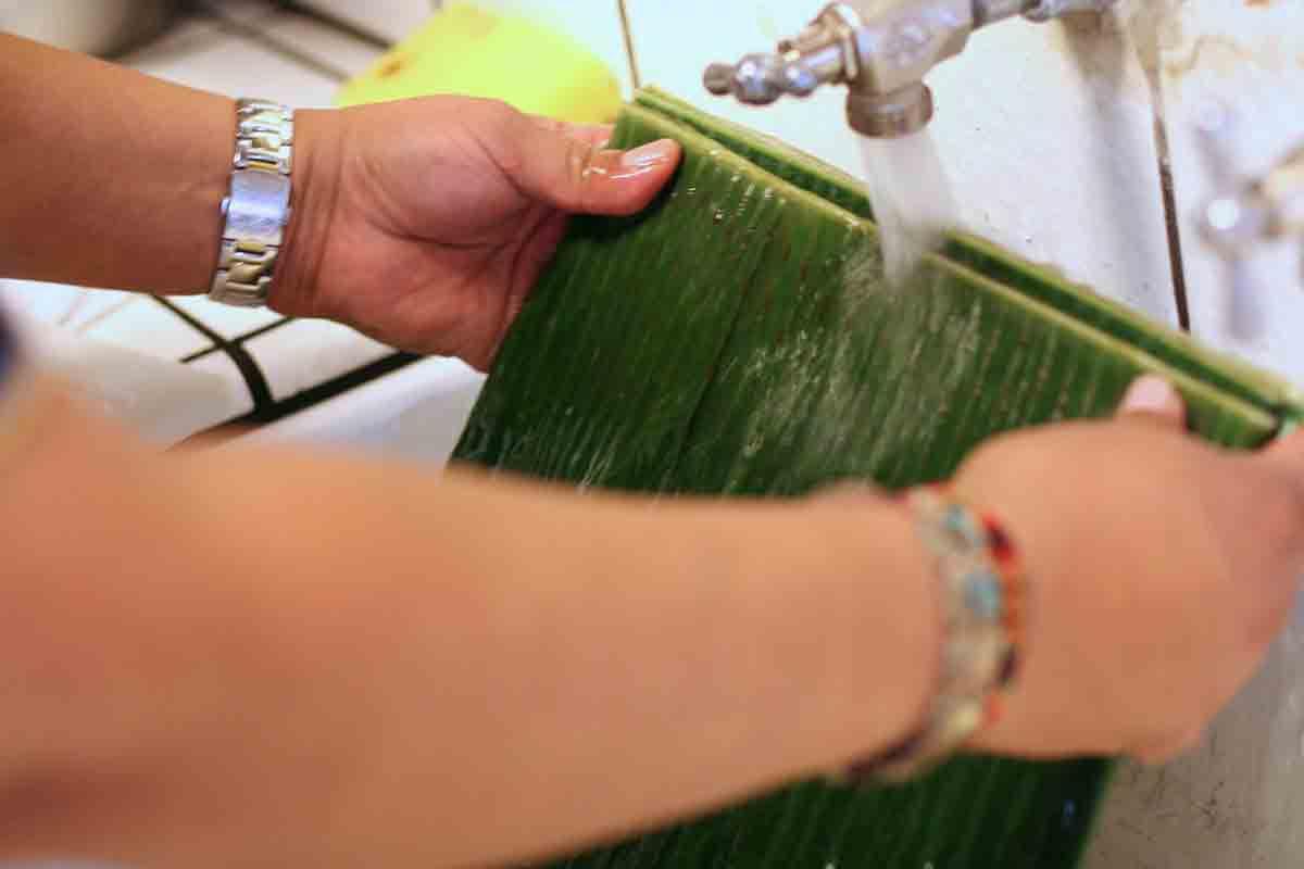 rinsing banana leaves