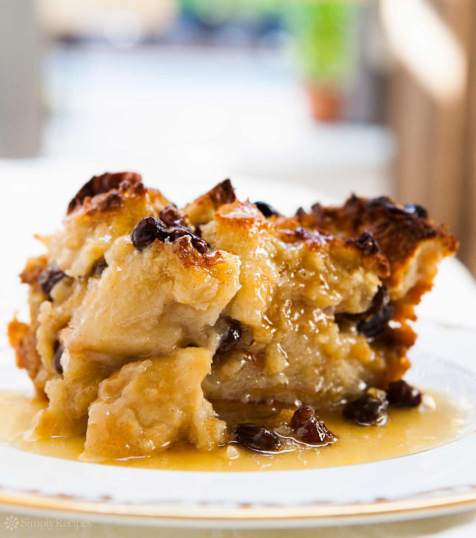 Best Bread Pudding on a white plate covered with bourbon sauce