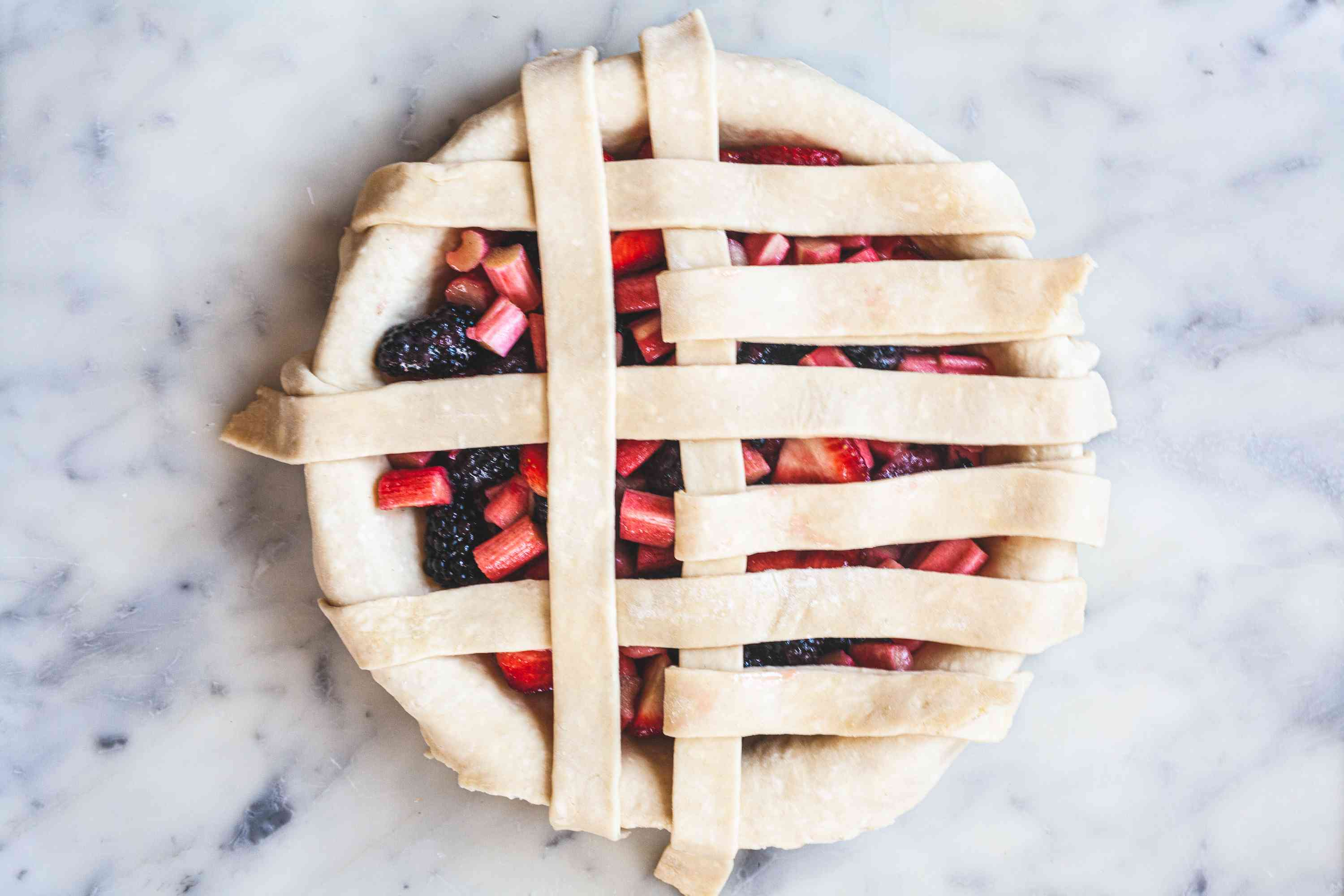 aying strips vertically to show how to make a lattice crust.