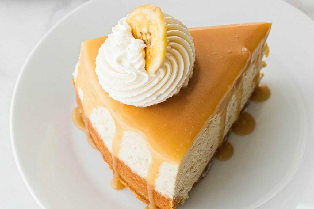 Banoffee Pie Cheesecake Recipe - slice of pie with cream and banana