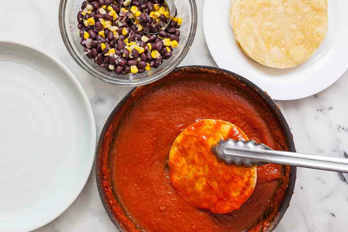 Vegetarian Enchilada Stack dip the tortilla in the sauce