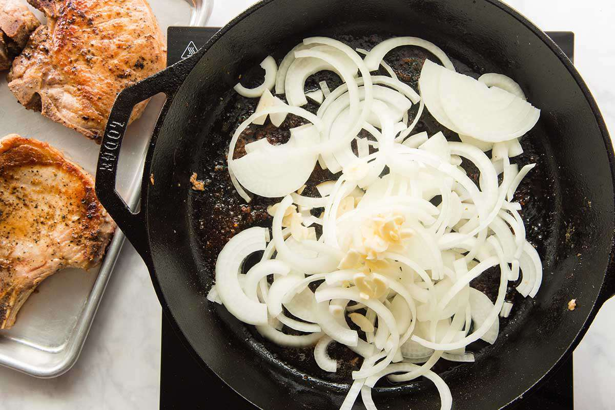 Onions sauteed in a cast iron skillet