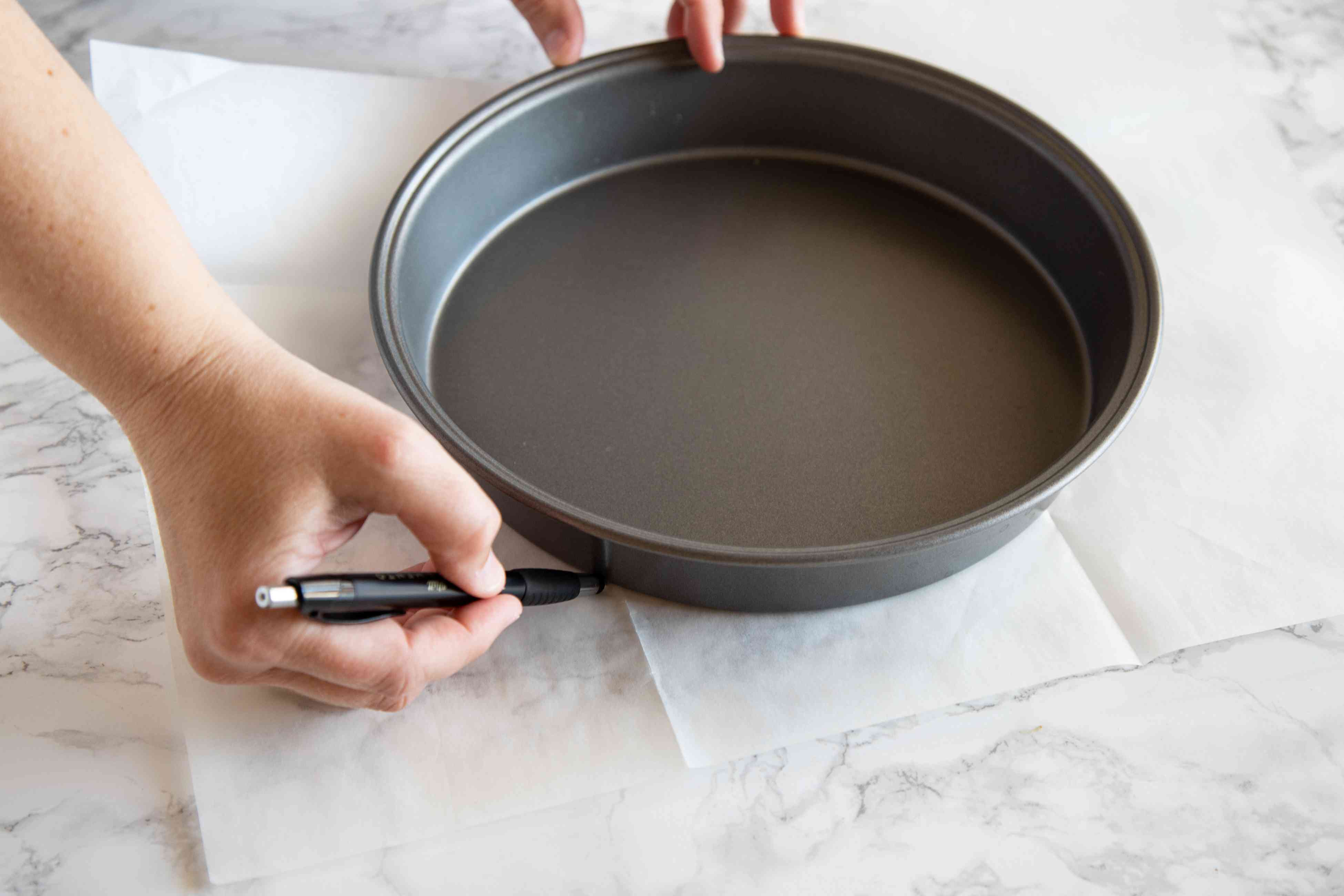 Tracing the bottom of a cake pan to make a Quick and Easy Earl Grey Yogurt Cake.