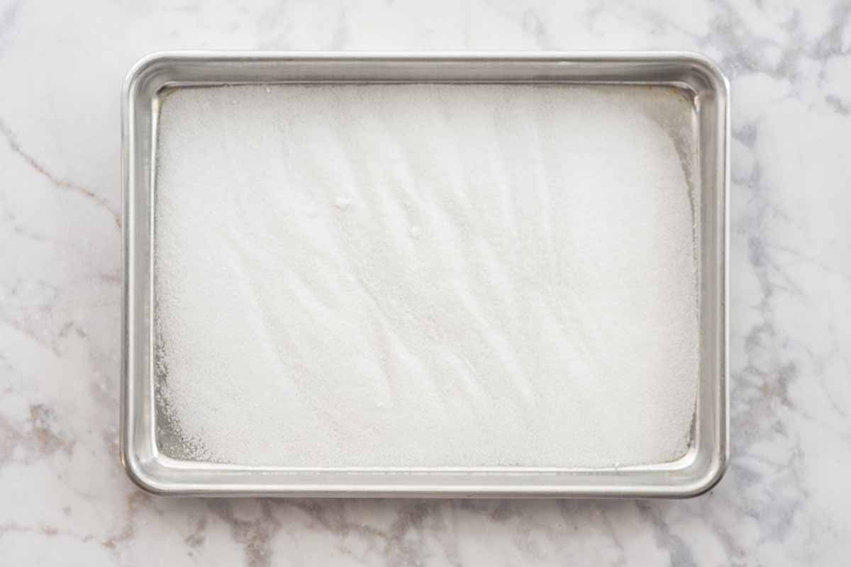 Authentic Tres Leches Cake Recipe coat pan with sugar