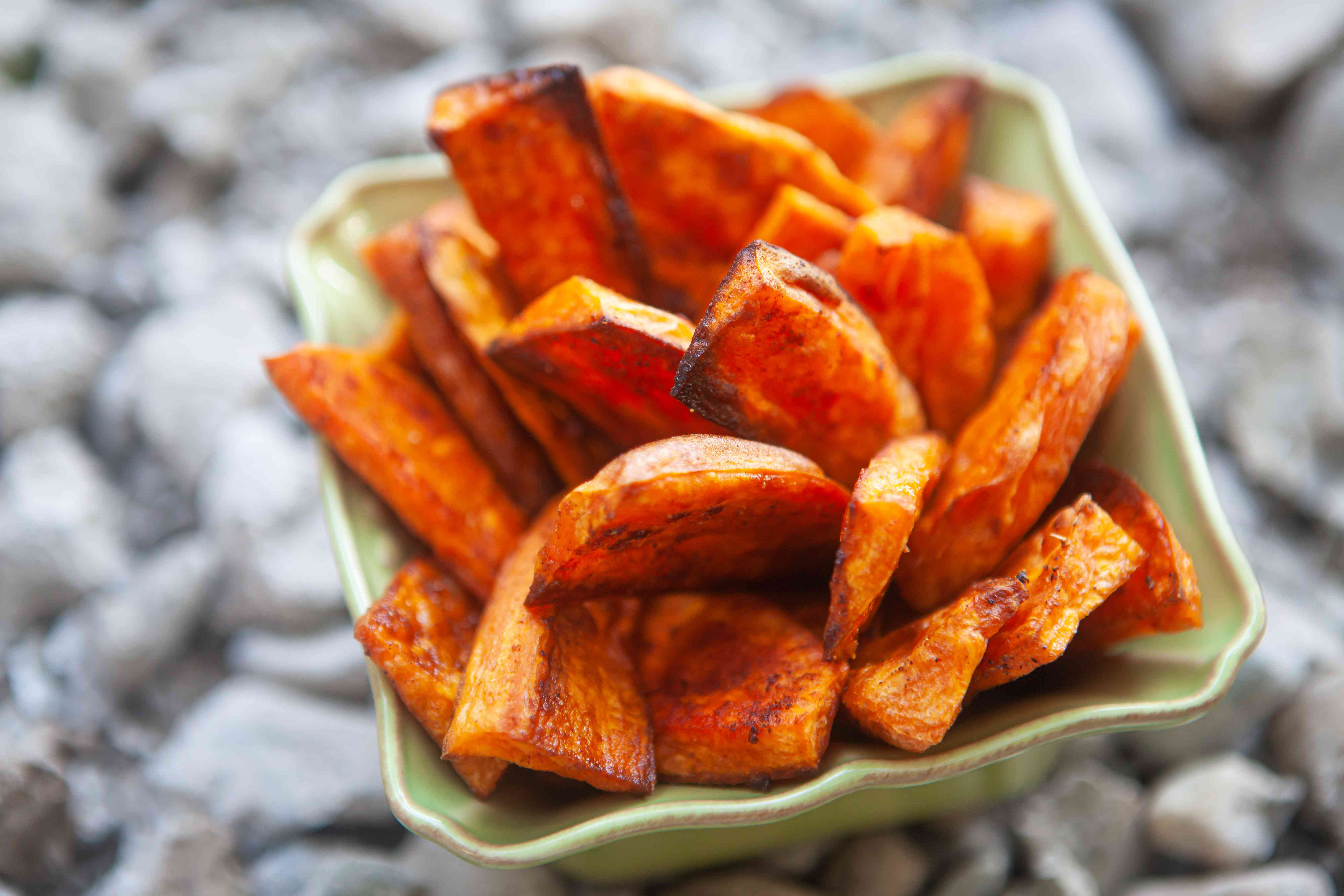 Sweet potato fries stacked in a container.