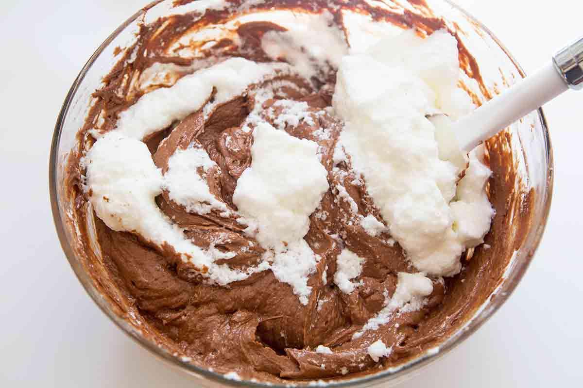 gently fold beaten egg whites into chocolate egg flour mixture to make batter