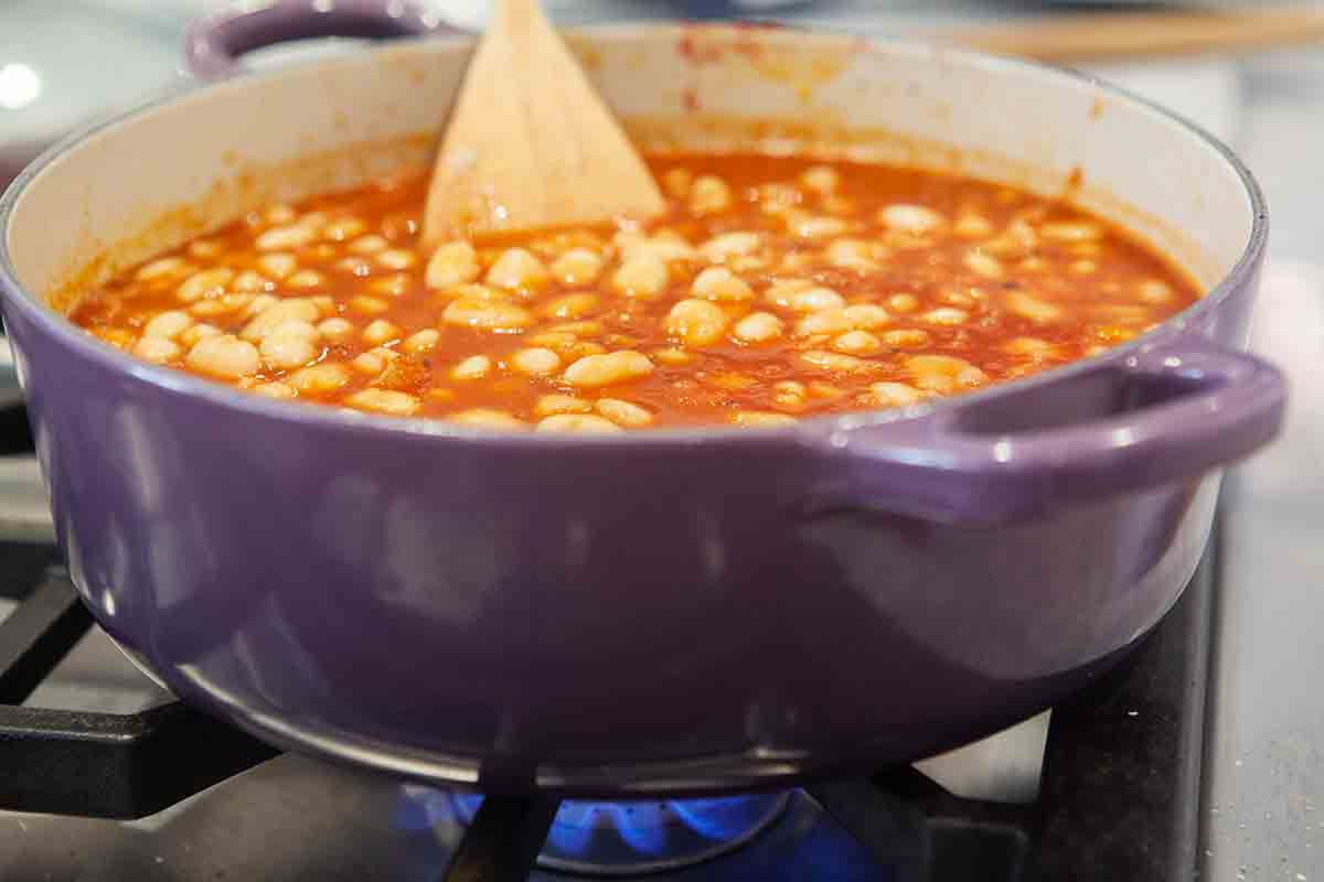 add beans to tomato sauce in pot