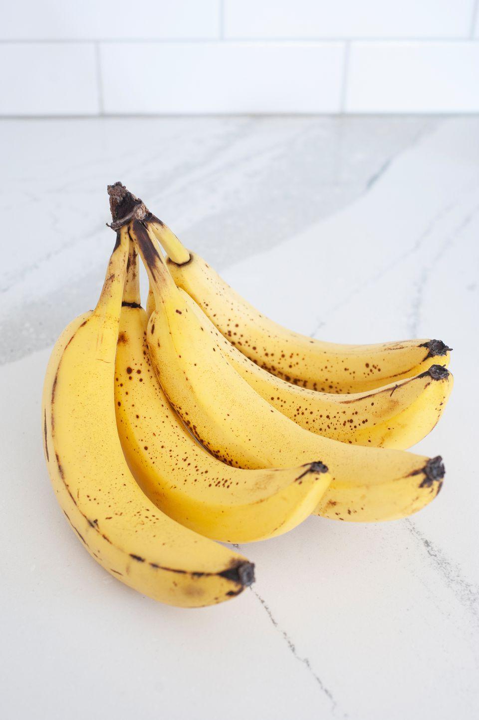Bunch of bananas on a white countertop