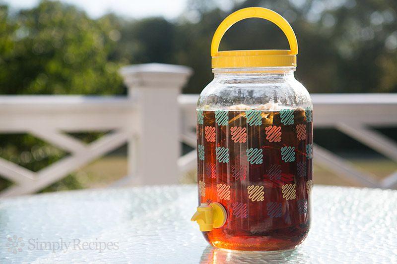 A jug of sun tea on a patio table