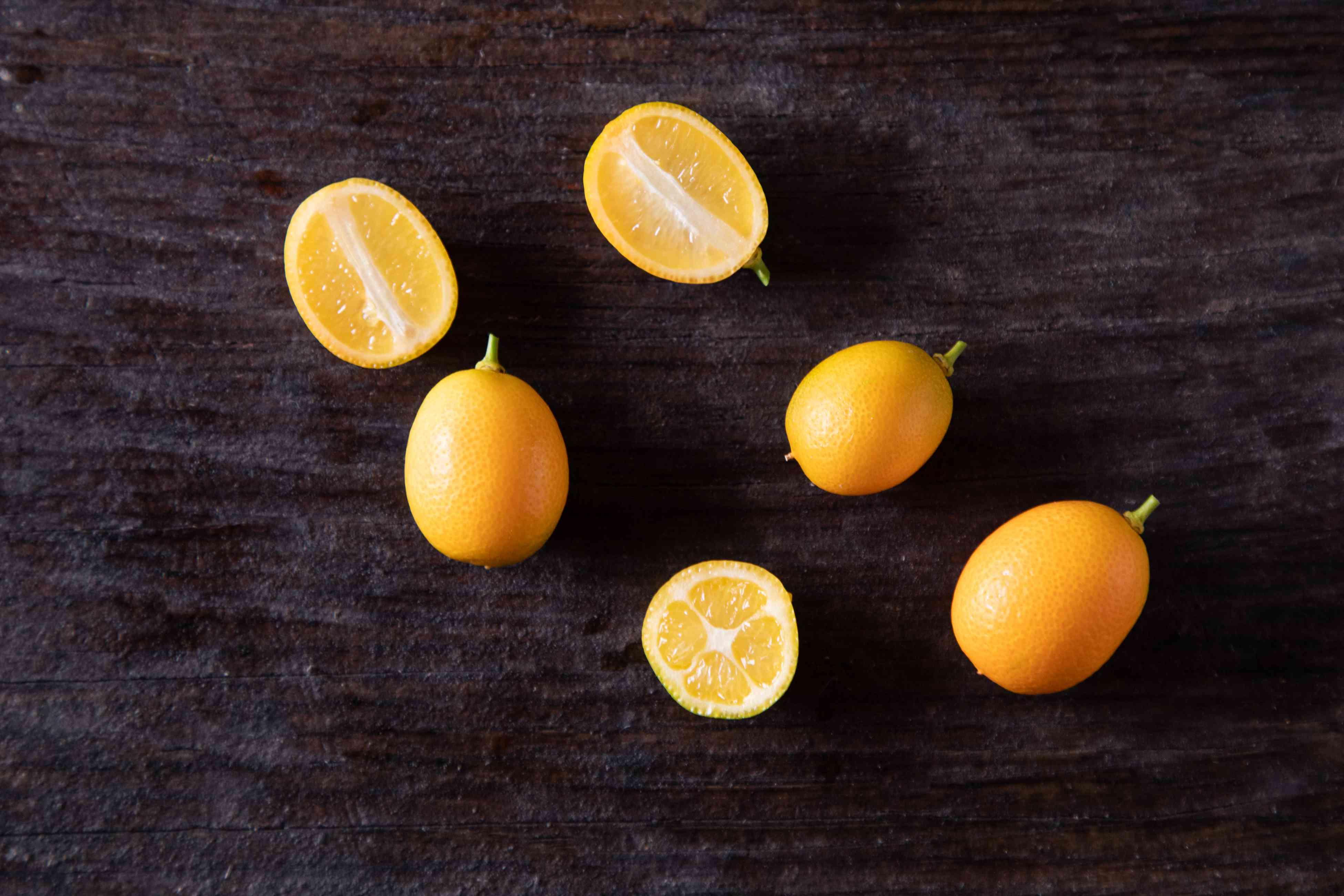 Kumquats on dark background