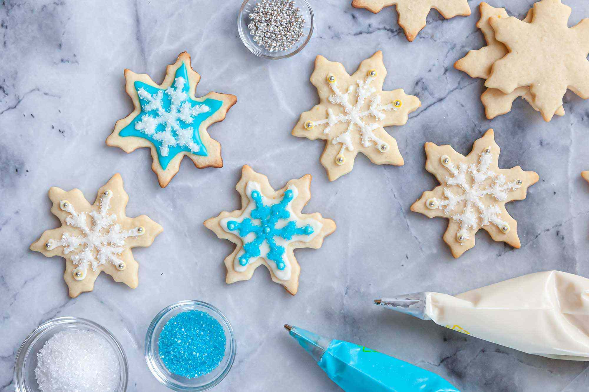 Snowflake sugar cookies decorated with Royal icing for sugar cookies.