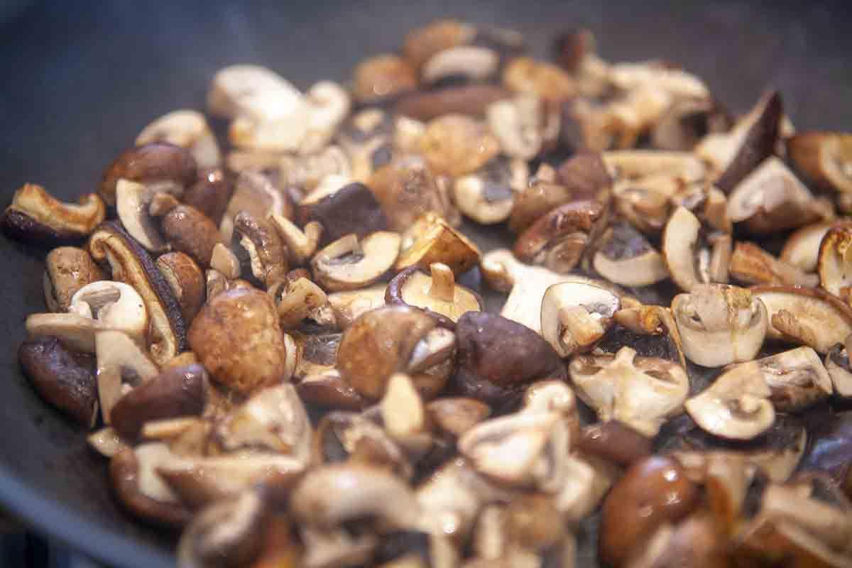 cook mushrooms in pan for beef stew