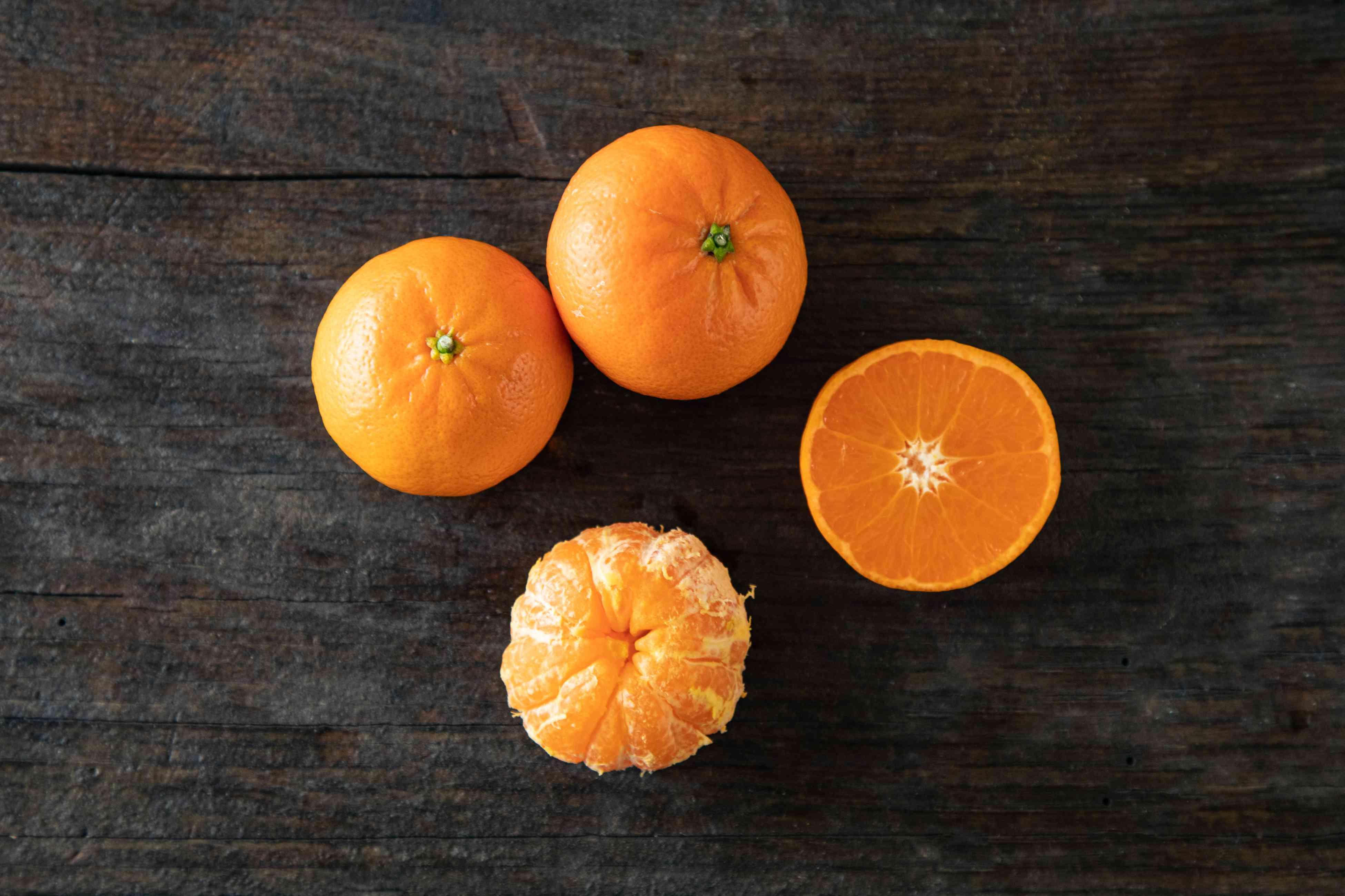 Clementines on dark background
