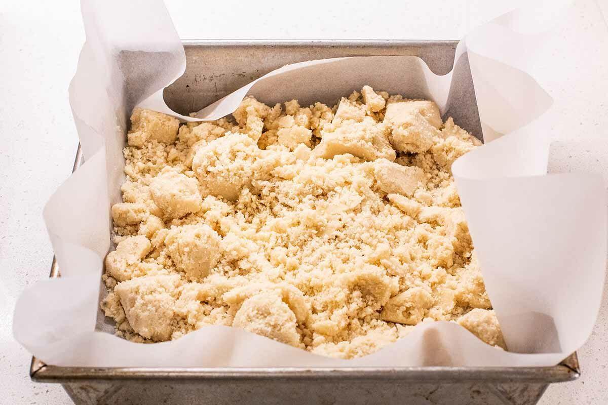 Best Ever Pecan Pie Bars add crust to pan