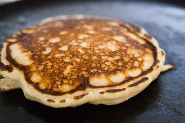 Fluffy blueberry pancakes on skillet