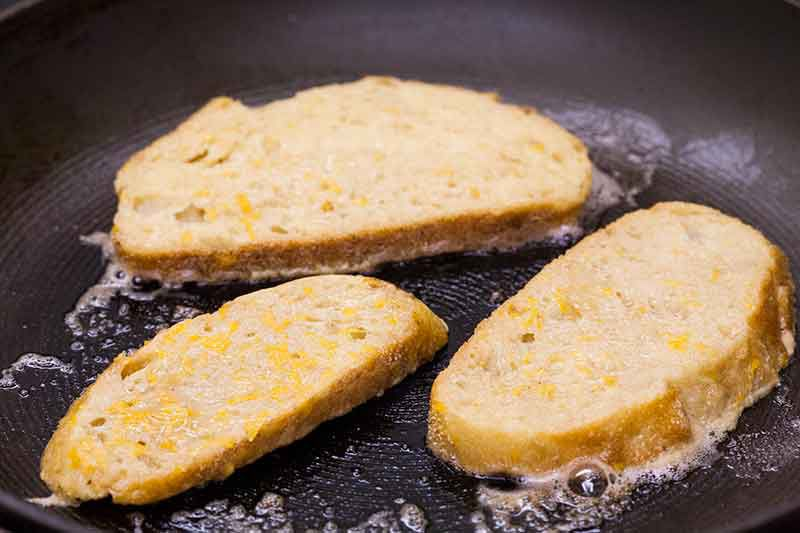 French toast browning in skillet