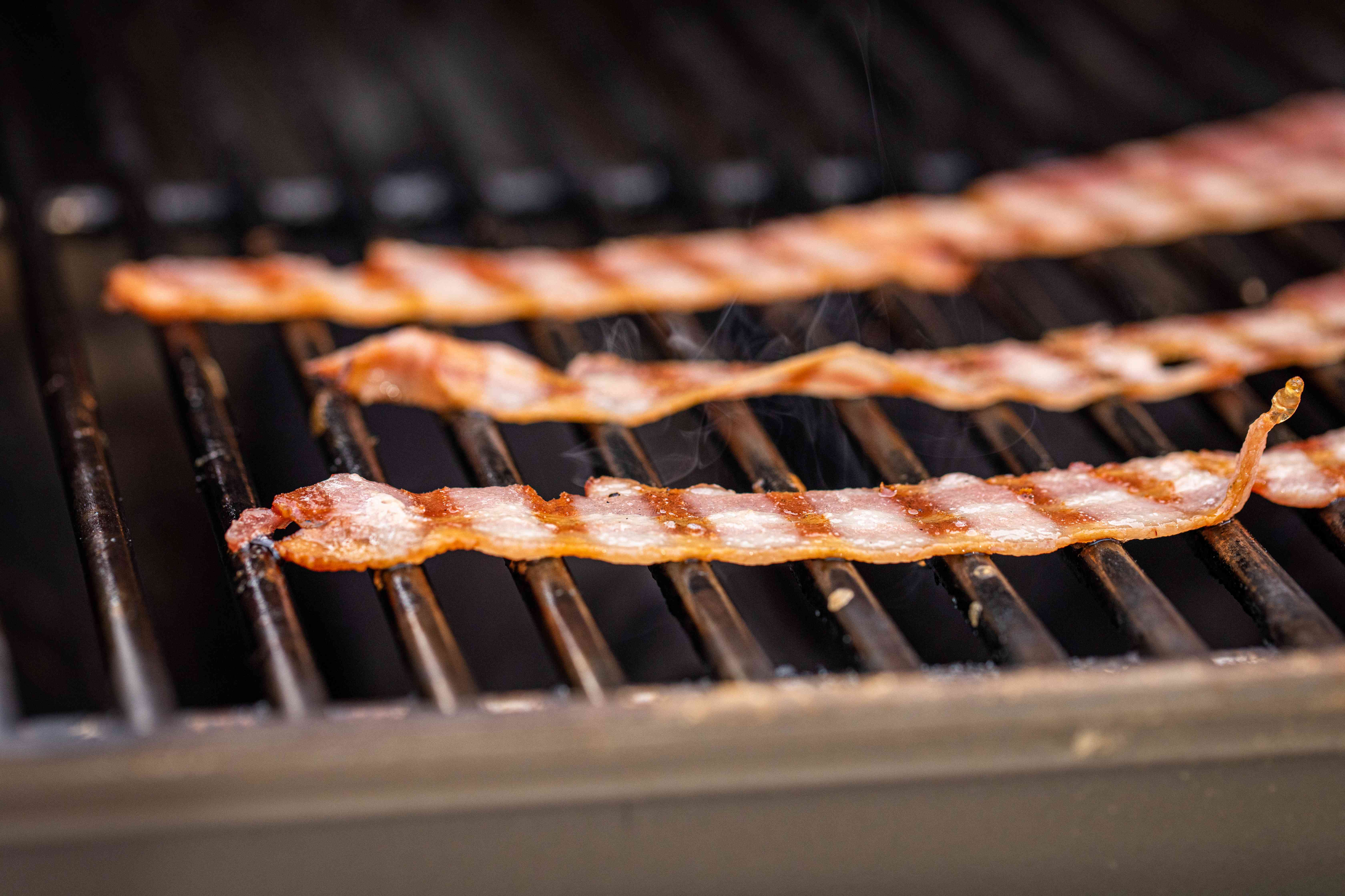 Bacon on a grill for the best bacon cheeseburger