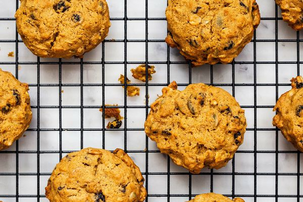 Pumpkin cookies cooling on a rack.