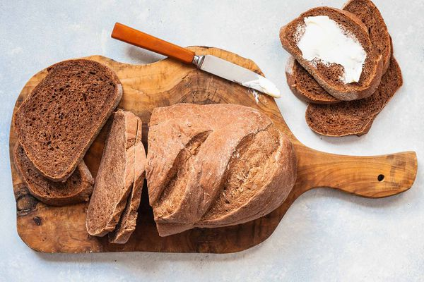 Homemade dark rye bread on a wooden board