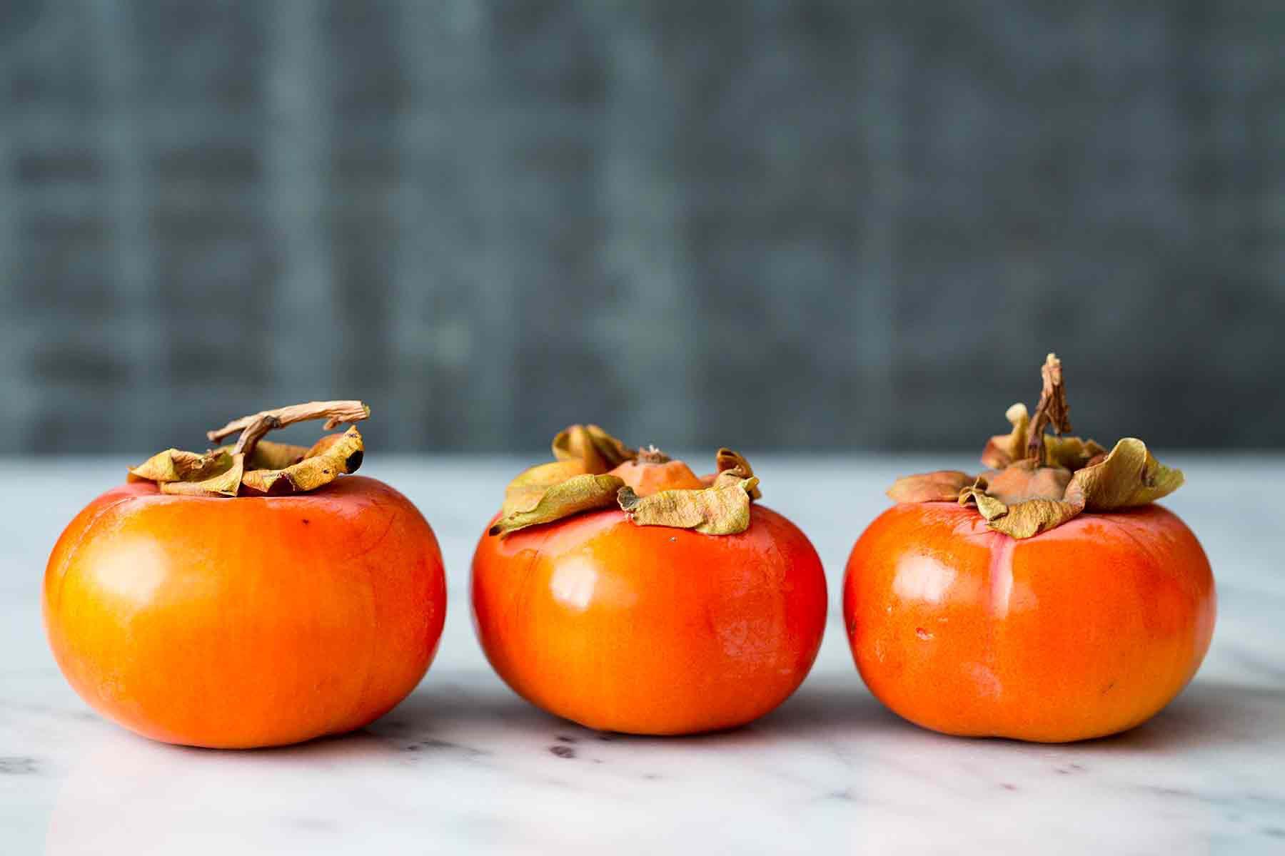 Fuyu Persimmons look like squat orange tomatoes