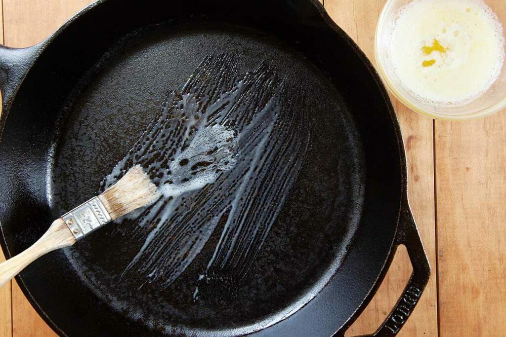 Brush cast iron skillet with butter for angel biscuit recipe