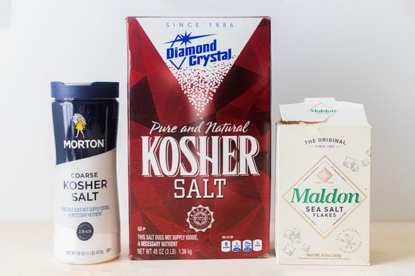 Three types of branded coarse salt lined up.