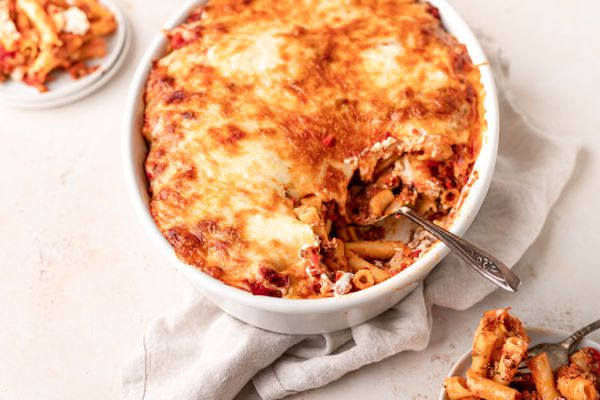 Oval baking dish filled with a cheesy pasta bake
