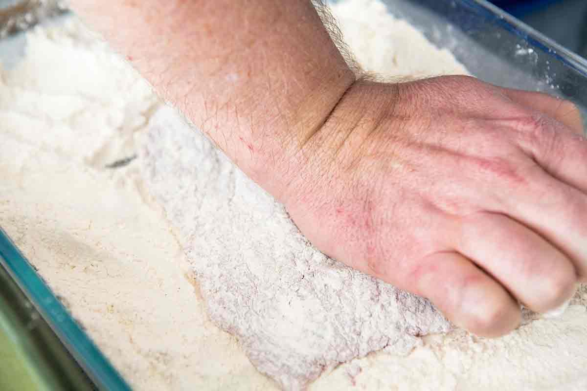 rolling steak in flour