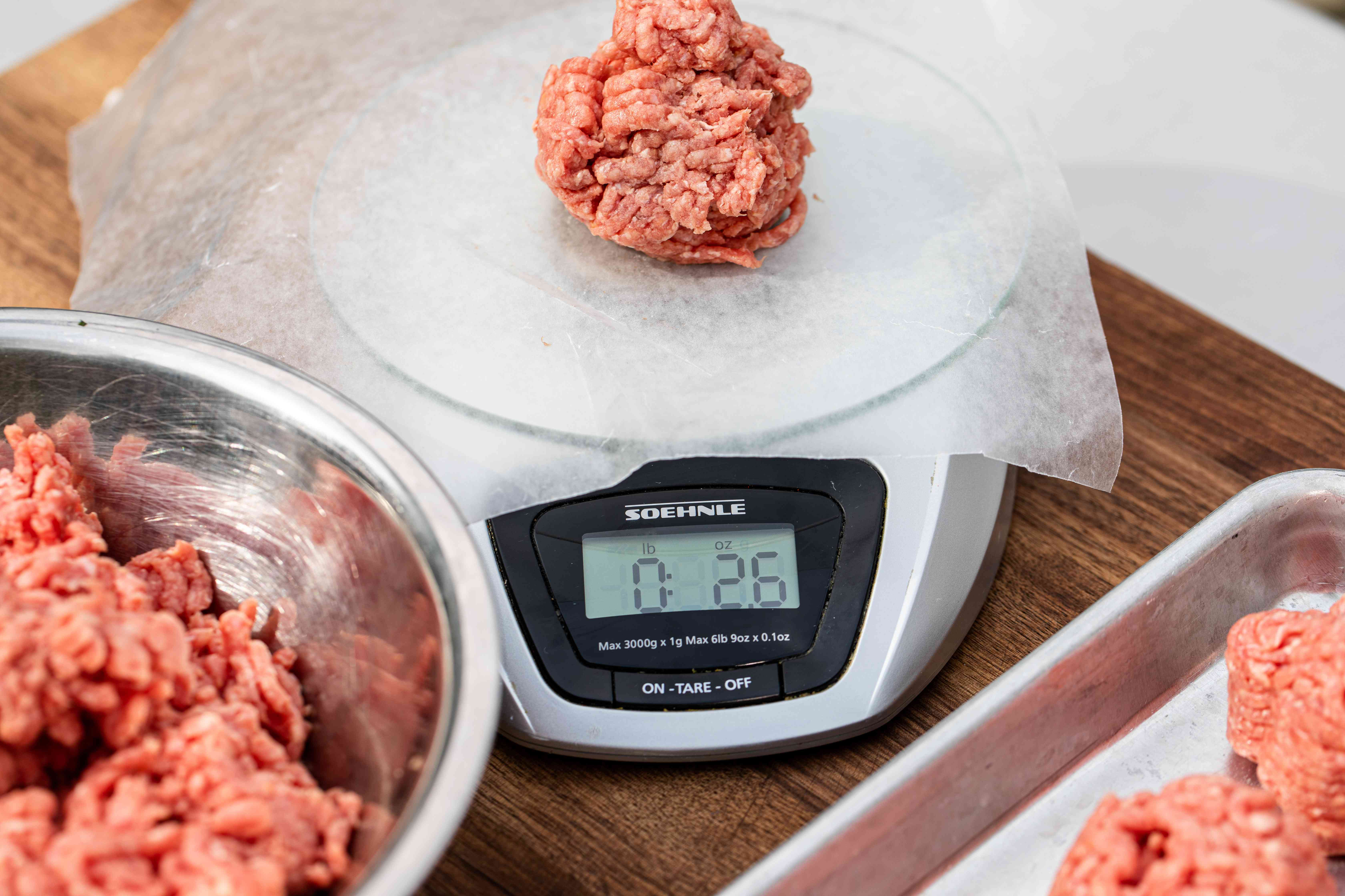 Weighing ground beef to make a Juicy Lucy burger recipe.