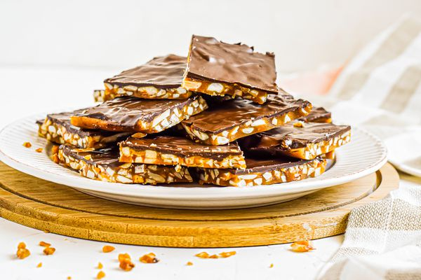 Side view of roca candy piled on a plate.
