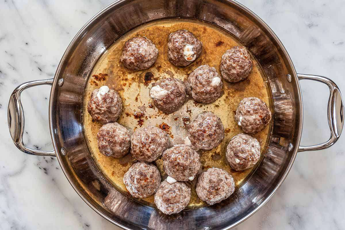 Cheese Stuffed Meatballs - meatballs in skillet