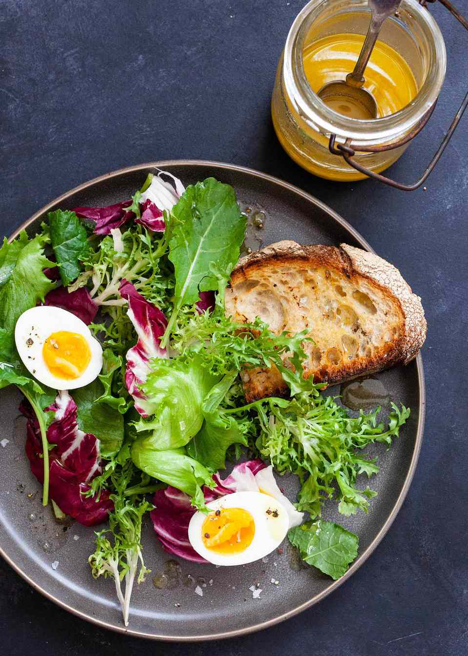 Side Salad with Eggs -- salad greens with hard boiled eggs and toast