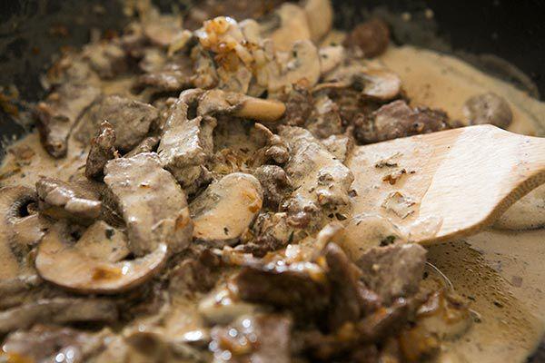 mixing ingredients into beef stroganoff sauce