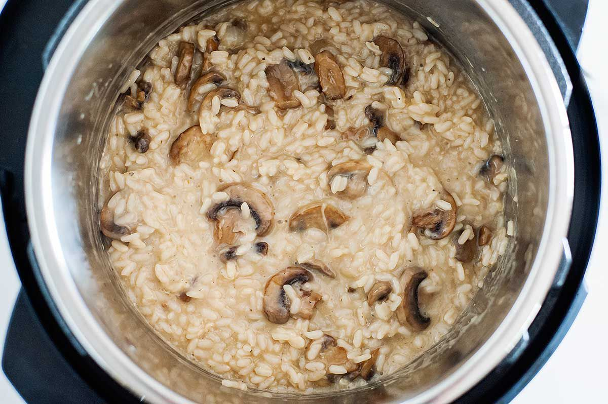 Easy Mushroom Risotto - photograph of risotto and mushrooms inside the bowl of an instant pot