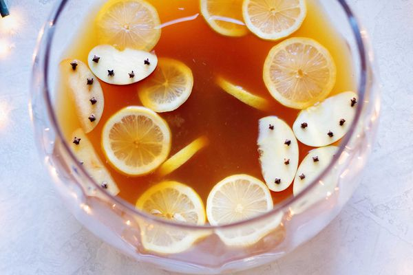 Glass punch bowl filled with Spiced Brandy and Chai Tea Holiday Punch
