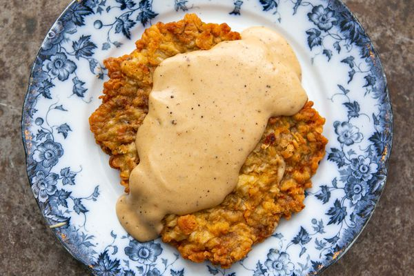 Easy chicken fried steak covered with gravy on a plate