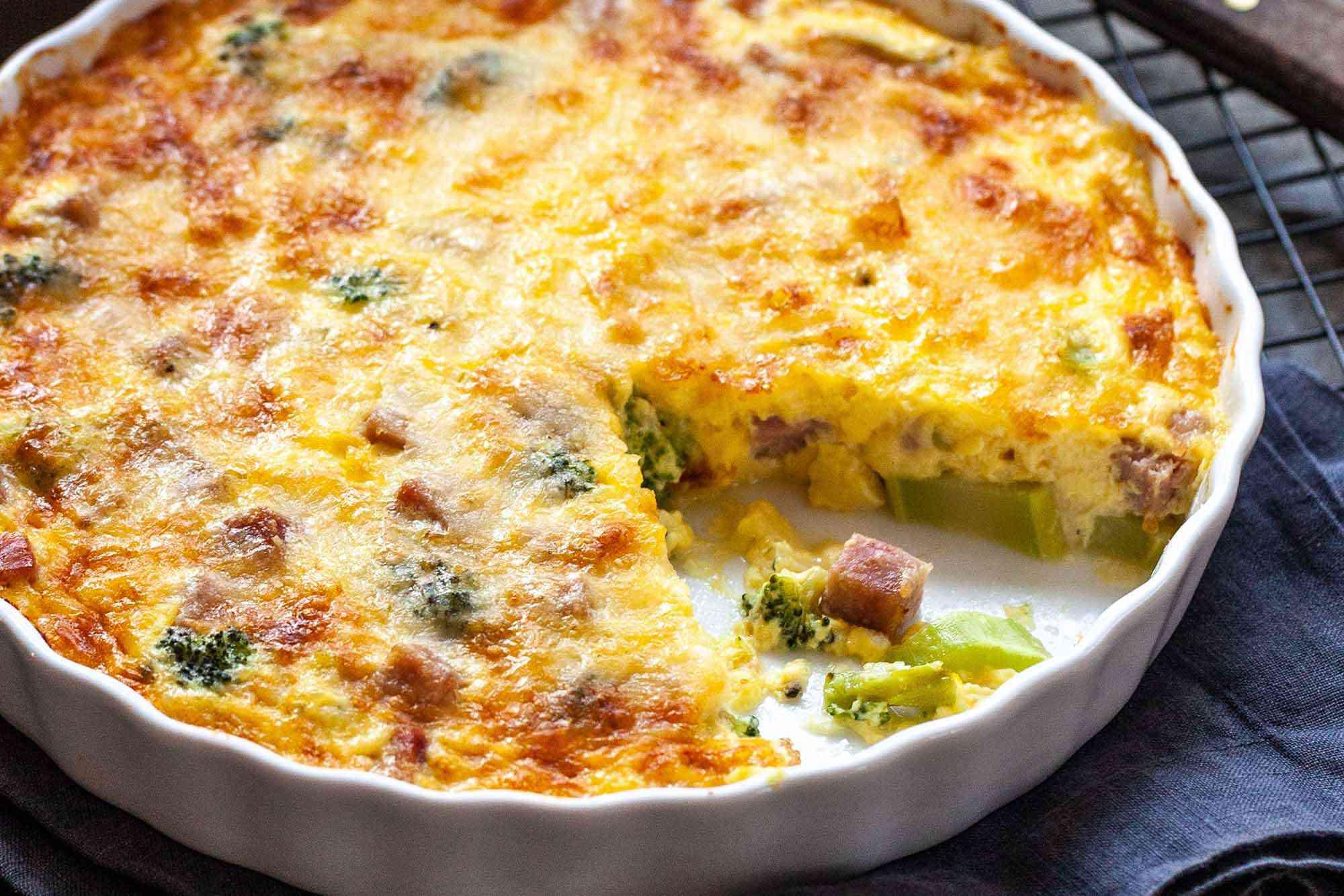 Crustless Quiche with Ham - close up of ham and broccoli quiche in a white dish