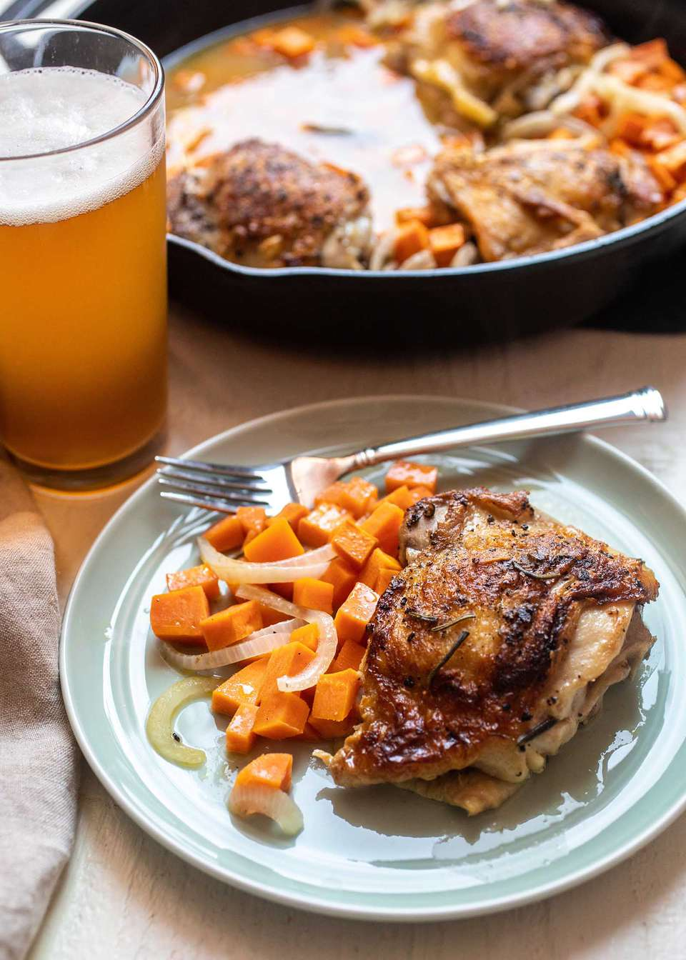 Weeknight one-pot skillet dinner cider-braised chicken thighs with sweet potatoes