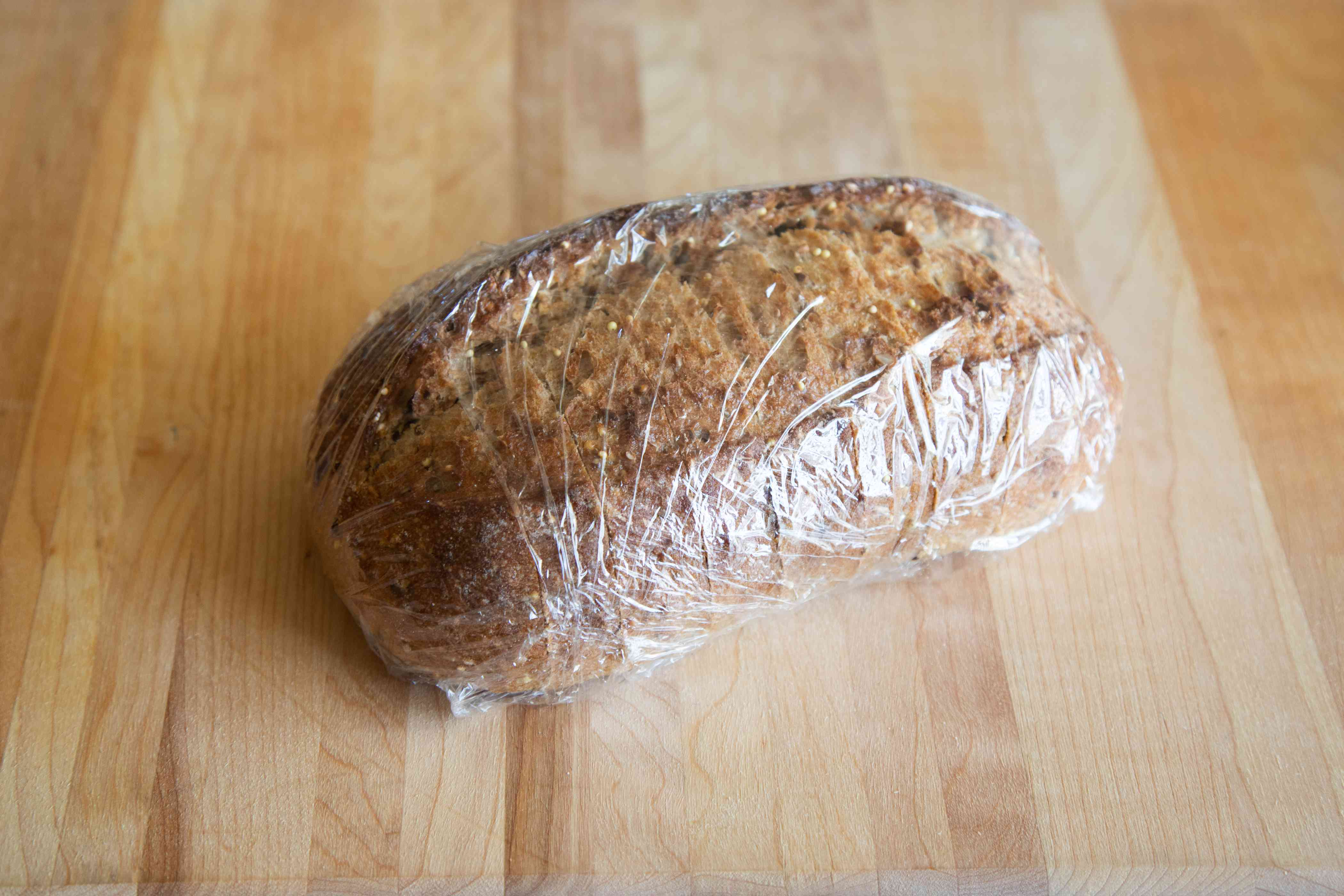Bread loaf wrapped in plastic wrap