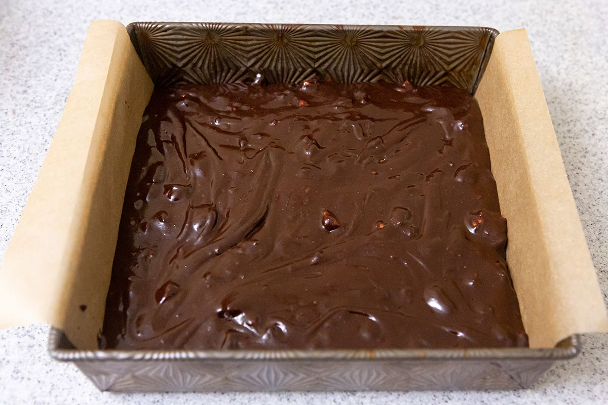 A pan filled with batter to make brownies from scratch.
