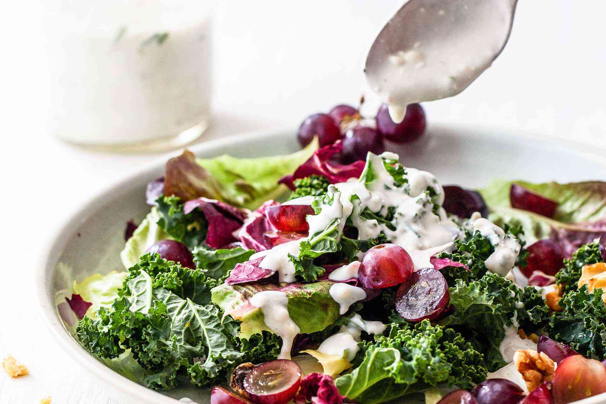 Mixed Green Salad -- colorful salad in a bowl with blue cheese dressing